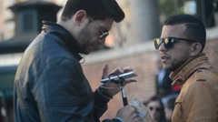 Rome Italy - Young men with Mobile phone at selfie stick browse photoes Stock Footage