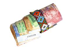 Roll of South African Banknotes Secured with Zulu Beads - stock photo