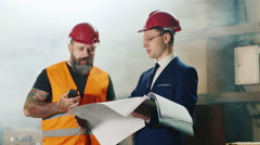 Teamwork of builders and engineering. Construction worker talking on the radio - stock footage