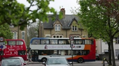 Red double decker bus paying through the shot in Oxford - stock footage