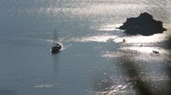 Santorini, Greece. A vintage sailing ship sails through the Santorini caldera at - stock footage