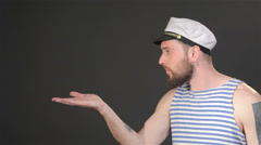 Side view of bearded captain sends air kiss Stock Footage