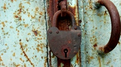 Rusty lock hanging on the door Stock Footage