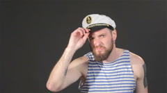 Bearded captain tidies himself - stock footage