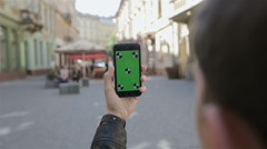 Man taking photo with camera phone in Lviv,Ukraine. Stock Footage