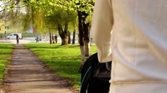 Mother walking with baby Stock Footage