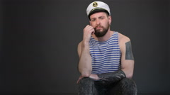 Bearded sailor gets bored Stock Footage