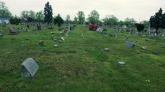 Somber Walk through a Cemetery Stock Footage