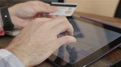 Shopping on-line with credit card on digital tablet.close up Stock Footage