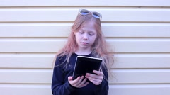 Portait of Teenage Blond Girl With Tablet - stock footage