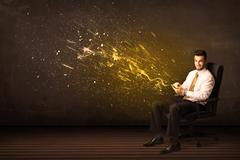 Businessman with tablet and energy explosion on background Stock Photos