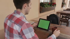 Man drink coffeTablet with Green Screen.Causal Lifestyle. Stock Footage