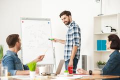 Talented young team is working with joy - stock photo
