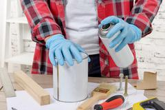 young man with aerosol paint - stock photo