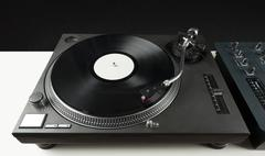 Turntable playing vinyl close up with needle on the record - stock photo