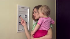 Woman child turn switch Stock Footage