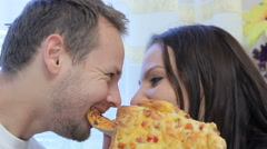 Lovers funny eat pizza Stock Footage