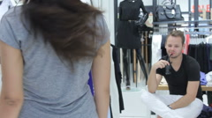 Girl shows new dress in shop Stock Footage