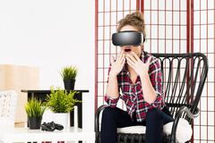 Girl getting experience using VR-headset glasses of virtual reality Stock Photos