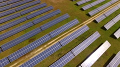 Aerial Fly Over Solar Power Panels Field Green Energy Clean Energy Production Stock Footage