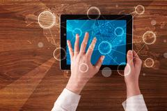 Business hands holding tablet - stock photo