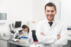 Successful male researcher is expressing positive emotions - stock photo