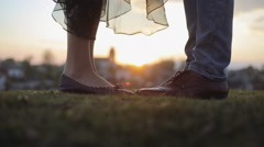 Male and female legs during a date. close up Stock Footage