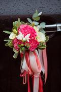 Luxury black wedding car decorated with flowers Kuvituskuvat