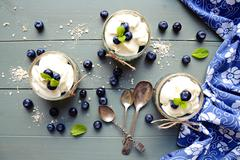 Granola desserts with blueberries Stock Photos