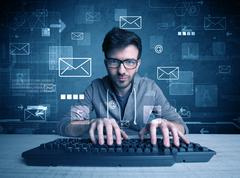 Intruder hacking email passcodes concept - stock photo