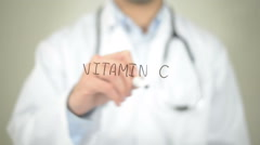 Vitamin C , Doctor writing on transparent screen Stock Footage