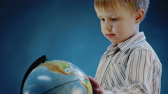 Little boy rotates the globe Stock Footage