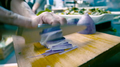 Chef Chopping Purple Daikon Radish in a Restaurant Stock Footage