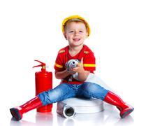 Cute toddler fireman - stock photo