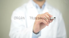 Organ Transplantation , Doctor writing on transparent screen Stock Footage