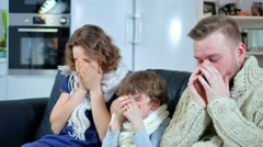 A family of father, mother and the boy got sick, sneezing without end Stock Footage