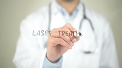 Laser Treatment , , Doctor writing on transparent screen - stock footage