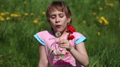 Girl blowing on a dandelion Stock Footage
