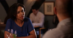 4k, A disagreeing couple having a heated argument while on date at a restaurant. Stock Footage