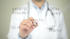Health Care Concept, Doctor writing on transparent screen Stock Footage