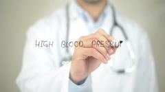 High Blood Pressure, Doctor writing on transparent screen Stock Footage