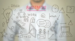Business, Concept Illustration, Man writing on transparent screen Stock Footage