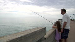 Grandpa Fishing With Grandkids Off of Pier At Ocean Stock Footage