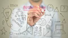 Business Plan, Concept Illustration,  Man writing on transparent screen - stock footage