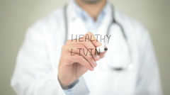 Healthy Living, Doctor writing on transparent screen Stock Footage