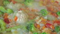 Stewing vegetables in a wok Stock Footage