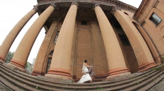 Wedding Couple near historic building with columns Stock Footage