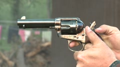 Colt 45 pistol shoots and fires aiming gun Stock Footage