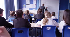 4k, Handsome teacher teaching a classroom in front of a whiteboard. Slow motion. - stock footage