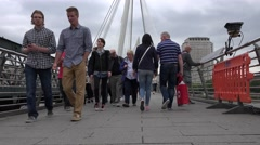 4K Hungerford Bridge in London, People, Tourists Walking, Crossing Thames River Stock Footage